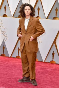Interesting choice:Composer Mica Levi went brown and baggy in this suit and hiking boot combo