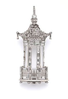 A diamond set pagoda brooch,  with baguette diamond columns and an open work roof set with rose diamonds in elliptical mille-grain settings, topped with a brilliant and rose diamond spire.  Probably French, circa 1930.