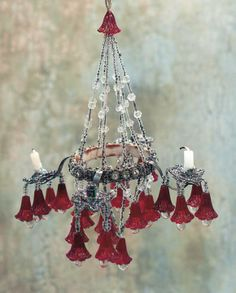 "Fine Cranberry Glass and Crystal Candelabra  7"" (18 cm.) h. A series of 26 cranberry glass petals with crystal interior tear drops are suspe..."