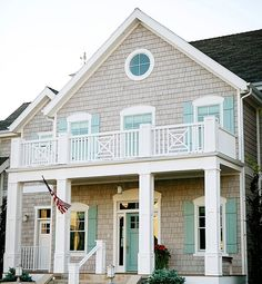 If you're feeling ambitious, then create the feel of a beachside retreat with an unexpected update to your home's exterior. A sand-and-sea color palette with nature-inspired textures will give you that coastal feel without the obvious mermaids or beach art, says Olson, who was dazzled by this home's pale-turquoise shutters.See more stunning turquoise spaces on House of Turquoise!