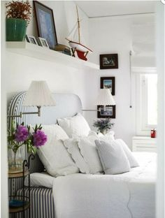 Lovely room..  Only I recommend that you do not put a shelf like this above your bed. (feng shui tip)