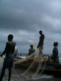 Fishermen. Gambia SATURN & CHIRON IN PISCES