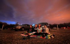 Leah Baughman, Alyssa Combs, Ally Weigand, and Maci Bush, all friends, sit on the ground rather than their car for a movie at the Magic City drive in theater Saturday, April 12, 2014, in Barberton. (Joshua Gunter/ The Plain Dealer)