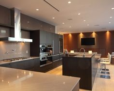 Would switch to dark floors and white/gray cabinets...change the hood...but love the modern clean feel