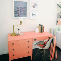 Colorful furniture pieces are given a place to shine in this bright white room. Quirky thrifted finds and unique details make up this space.