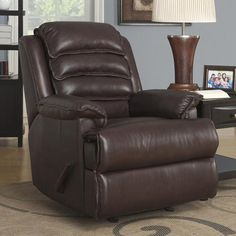 Top Grain Leather Rocker ReclinerTop Grain 100% leather on all seating surfaces (matching leather-look on outside back & outside arms)|Rocker recliner|Leggett & Platt mechanism TM|Sturdy hardwood/plywood construction with glued joints and corner blocks|Back comes detachable for ease of movement in and out of doors|Chaise lounge footrest|Push-back ease