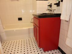 Partially remodeled bathroom gets some bold color with a custom color red vanity and black china counter/sink to go with the black and white theme