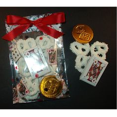 Casino white chocolate-covered pretzel knots with chocolate playing card and foiled coin (2.5-oz) in patterned bag with matching bow.* Great for special corporate events, graduation party favors, casino-related fund raisers, promotional items, or any other gaming-themed event. *Bow may be customized for additional charge.