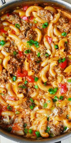 One-Skillet Mac and Cheese with Sausage and Bell Peppers, smothered in marinara sauce and cream. Everything is cooked in one skillet: sausage, bell peppers, and even pasta! Try this with (Ground Sausage Recipes) Pork Recipes, Pasta Recipes, Cooking Recipes, Recipes With Marinara Sauce, Recipies, Skillet Recipes, Skillet Dinners, Dinner Recipes, Cheese Recipes
