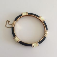 J.Crew Black & Beige Bangle This is a beautiful black and ivory bracelet. It has little crystals and opens so you can easily fit it around your wrist! It's only been worn a few times. J. Crew Jewelry Bracelets