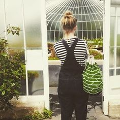 The talented Laura from Dear Prudence wearing our green duffel so well with her dungarees from Toast!