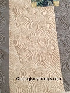 quiltingismythereapy.com  Love the combo of straight and curves and also the outside right edge in the darker color
