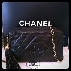 Vintage Chanel quilted handbag with tassel A true classic! Black lambskin leather with gold hardware. Excellent condition for a vintage piece. CHANEL Bags Crossbody Bags