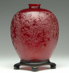 "R. LALIQUE Vase, ""Acanthes,"" cased red with original bronze stand, c. 1921."