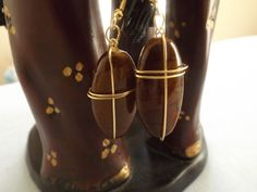 Brown wirewrapped cross dangle earrings by OutWord on Etsy, $5.00