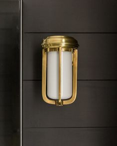 Elegant and versatile enough to hold its own inside or out, the Milton Sconce's sturdy metal frame lightly cages a white glass shade. Making Space, Glass Shades, Candle Sconces, Light Fixtures, Wall Lights, Lighting, Metal, Rock Creek, Powder