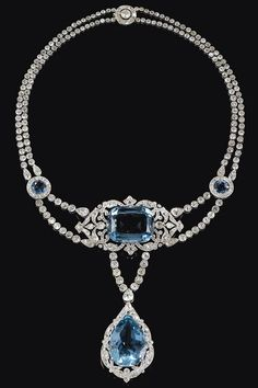 Aquamarine & Diamond Necklace. Cartier. 1912.In the garland style, centring on a cushion-shaped aquamarine within an openwork scroll frame of millegrain-set circular-cut diamonds, suspending a similarly set pear-shaped aquamarine drop, to a necklace designed as two graduated lines of circular-cut diamonds accented with a pair of circular aquamarine links, signed Cartier Paris, length approximately 380mm. | Sotheby's