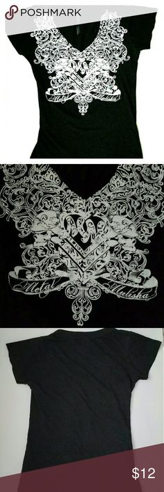 Metal Mulisha Black Top metal vibe Graphic sz Med. This a cool looking Metal Mulisha top, black  background, front graphic w/skulls in helmets, gothic metal look in white. Short sleeved with a V-neck. Metal Mulisha Tops
