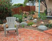 I love the use of salvaged bricks for this patio