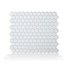 Hexago... fun, unique tiles. 3D Effect, more than just a self-adhesive wall tile. Easy to install peel and stick wall tiles. Guaranteed to stick on backsplash and over existing tiles or painted walls.