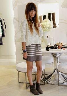 chunky asymmetrical sweater over dress