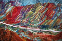 Danxia Landforms, China  These colorful rock formations are the result of red sandstone and mineral deposits laid down over millions of years. Wind and rain then carved amazing shapes into the rock, forming natural pillars, towers, ravines, valleys, and waterfalls.