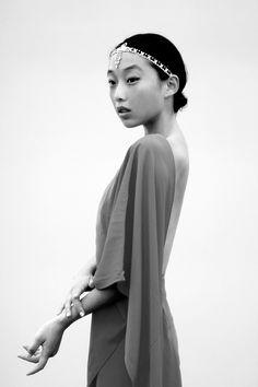 Margaret Zhang- I like this photo because she is exotic and elegant in this photo. This is expressed in the movement of her hands and her straight posture. The look in her face looks as if she captured something... [Asian beauty]
