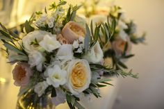 Adding small olive branches lends an appropriate Tuscan take on the bridesmaids bouquets, and the sprigs of rosemary provide a beautiful & subtle aroma