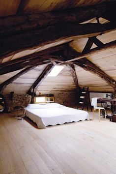 """""""the attic is like an upside down boat"""".  bedroom in the attic.  Renovated French Home in Lot Valley."""