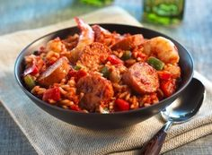 Quick Smoked Sausage Jambalaya Recipe. Enjoy this tasty southern entree made with kielbasa smoked sausage or low-fat kielbasa mixed with red onion, green pepper, celery, long-grain white rice, chicken broth, tomatoes, thume, and cayenne pepper. Ready in 15 minutes and serves four. Check out more National Hot Dog and Sausage Council Recipes online. Photo Via: Essence.