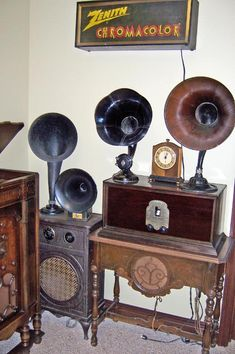 I love antique radio collections! (Atwater Kent AC metal console, horn speakers, Murdock Model 2A early AC set, unknown speaker table, Hammond clock.)