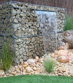 modern wood accents landscape design gabion wall - Google Search
