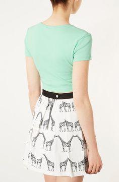 Minty shirt with giraffe skirt.