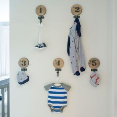 Creative Display: Wall hooks create a cute way to display the newest Decker's clothes, while addding to the decor of the room.