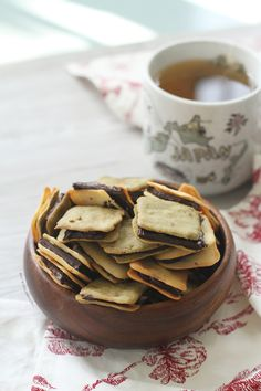 Langue de Chat Cookies   Thin crisp and buttery cookies that you can eat alone or with chocolate sandwiched in between. Best enjoyed with a warm cup of tea.