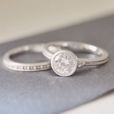 I love this ring set! Contemporary style for a timeless love. #BrilliantEarth #engagementring #weddingring #bridal #ido