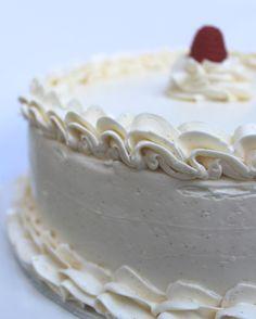 Lemon Raspberry Cake: layers of vanilla genoise cake filled with homemade lemon curd and fresh raspberries, topped with lemon vanilla buttercream.