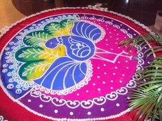 new-and-latest-peacock-rangoli-designs-6