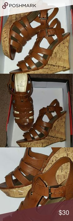 Guess leather Wedge Sandals Lighr Brown Guess Sandals.  Some oil on one shoe and a rip on the cork is shown in picks. They are comfy but not if you have wide toes. Guess Shoes Wedges
