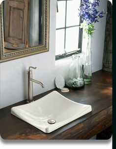 Love the rustic wooden countertop and bio-stuff nearby
