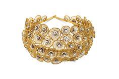 Bina Goenka hair band with gold frills and diamonds.
