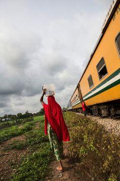 Nigeria - A woman walking along the train tracks near the Guni stop | Glenna Gordon, NYT