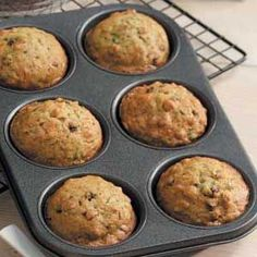 """Zucchini Muffins Recipe -""""These yummy zucchini bread muffins, packed full of currants and walnuts are an excellent way to use up your garden overload of zucchini,"""" raves Peg Gausz of Watchung, New Jersey. Yummy Zucchini Muffins, Zucchini Muffin Recipes, Recipe Zucchini, Blueberry Breakfast, Breakfast Recipes, Dessert Recipes, Desserts, Breakfast Muffins, Vegan Breakfast"""