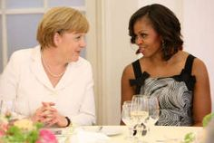 BERLIN, GERMANY: German Chancellor Angela Merkel speaks to U.S. First Lady Michelle Obama at a dinner at the Orangerie at Schloss Charlottenburg palace on June 19, 2013 in Berlin, Germany. President Barack Obama is visiting Berlin for the 1st time during his presidency & his speech at the Brandenburg Gate is to be the highlight.