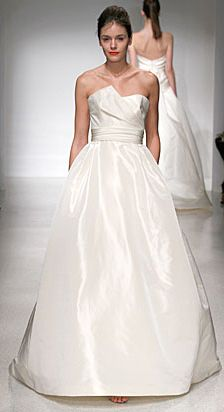 'Lauren' by Amsale.  Strapless Silk Faille A-Line gown with asymmetrical neckline and bow detail at back.