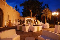 The wedding party is ready to begin at www.villalalimonaia.it Our Lava Stone Patio has been arranged like a huge living room!