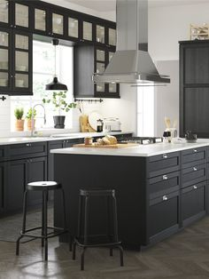 Add a taste of traditional craftsmanship to your kitchen. High quality LERHYTTAN doors in black stain are designed to stand the test of time. With its distinct traditional character and solid wood frame LERHYTTAN creates a cosy kitchen with rustic charm. Cosy Kitchen, Kitchen Decor, Kitchen Design, Kitchen Ideas, Kitchen Inspiration, Black Kitchens, Home Kitchens, Black Ikea Kitchen, Modern Outdoor Kitchen