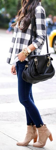 Ankle boots + flannel. Blacks and white plaid top shirt with denim leggings and ankle booties. Cute oversized bag too.