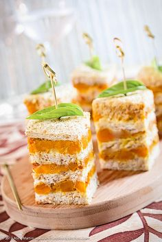 Terrina di pane, zucca e pasta di curry rosso||Literally ~ Bowl of bread, Pumpkin and Red Curry paste. Layers of bread spread w/filling between each layer, then sliced into tall squares and secured with a bamboo skewer speared through a basil leaf.