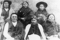 Comanche men, including Tabananica (aka Sound Of The Sun, aka Hears The Sun Rise) sitting on the far left - no date